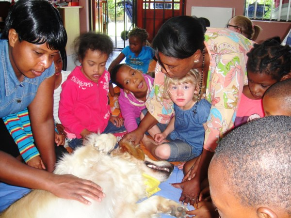 Children petting dog. Humane Education Trust. End Rabies Now.
